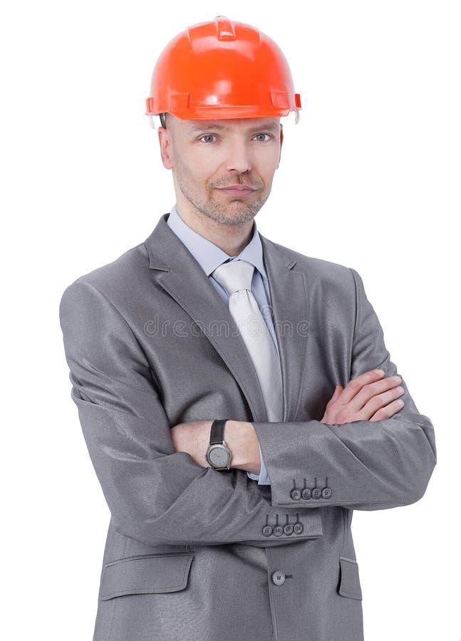 Retrato del ingeniero confiado en casco anaranjado imagenes de archivo