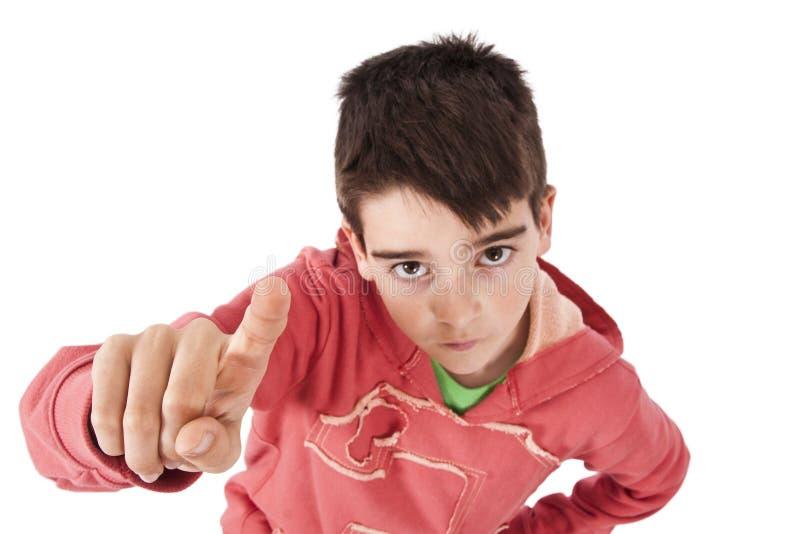 Retrato del muchacho con el finger aumentado foto de archivo