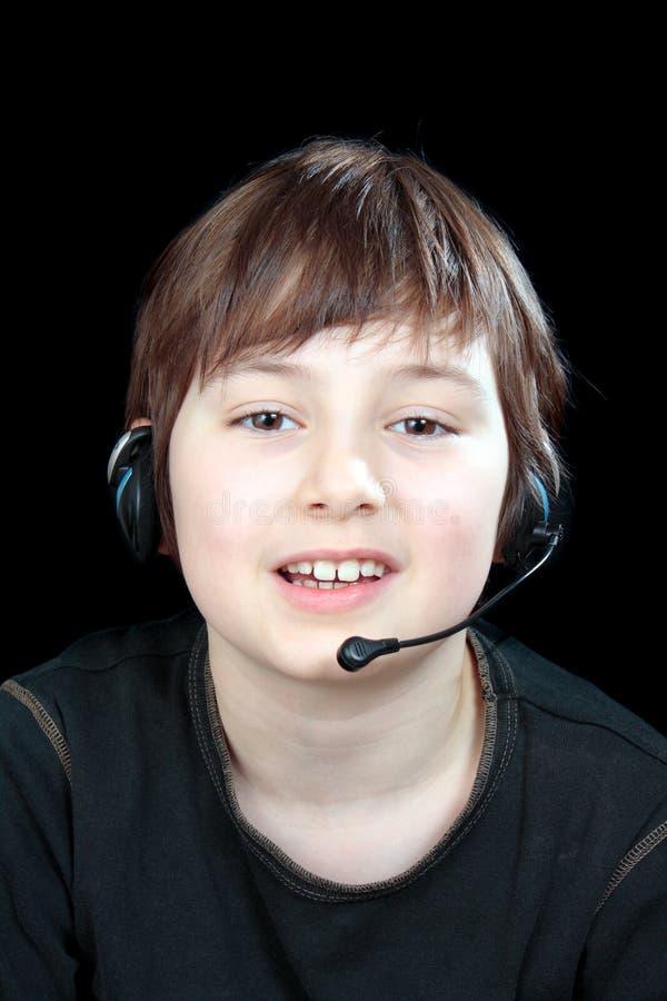 Retrato del niño mientras que charla fotografía de archivo libre de regalías
