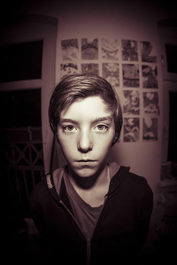 Retrato del ojo de pescados de un muchacho del adolescente foto de archivo libre de regalías