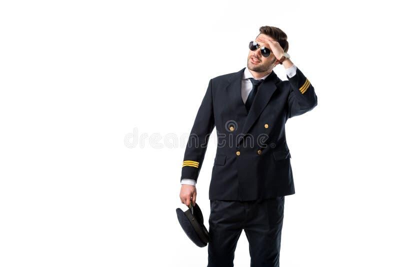 retrato del piloto joven en las gafas de sol que miran lejos imagenes de archivo