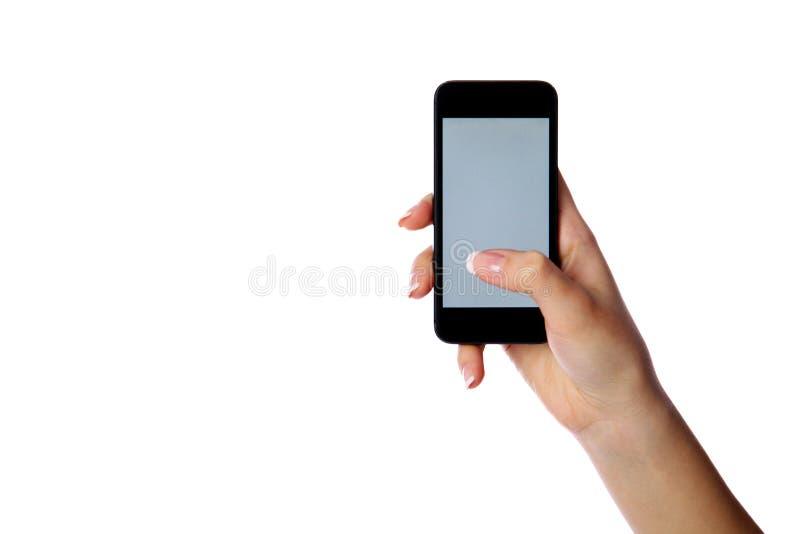 Retrato del primer de una mano femenina que sostiene smartphone foto de archivo