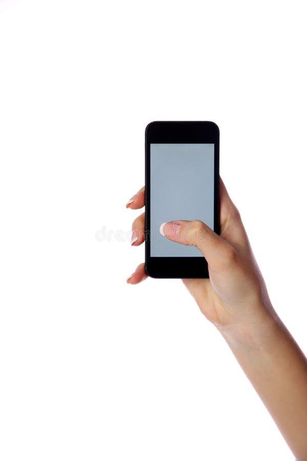 Retrato del primer de una mano femenina que sostiene smartphone fotos de archivo libres de regalías