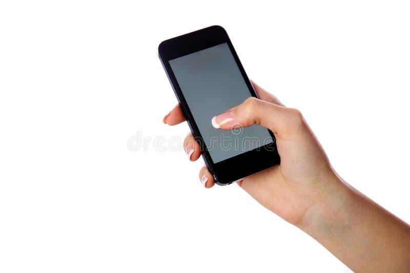Retrato del primer de una mano femenina que sostiene smartphone fotos de archivo