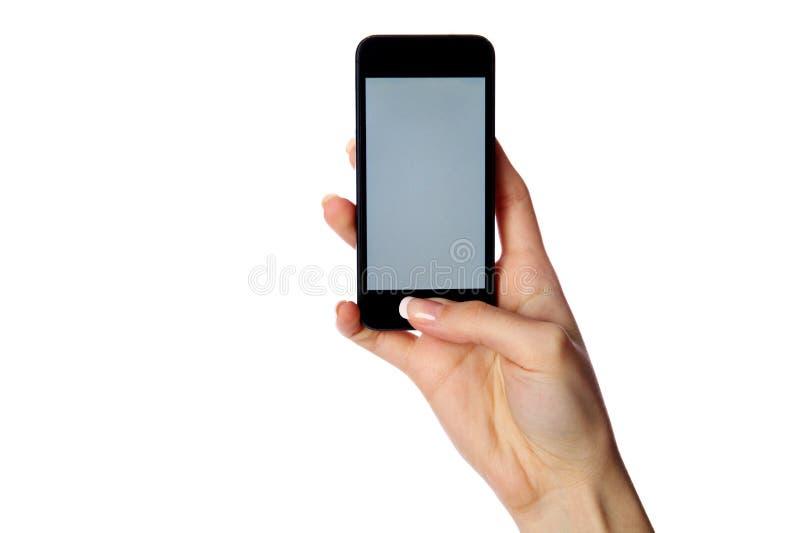 Retrato del primer de una mano femenina que sostiene smartphone imagen de archivo libre de regalías