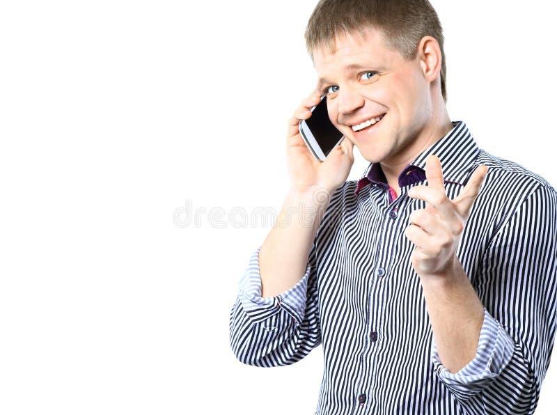 Retrato del primer del hombre de negocios joven usando el teléfono móvil imagen de archivo libre de regalías
