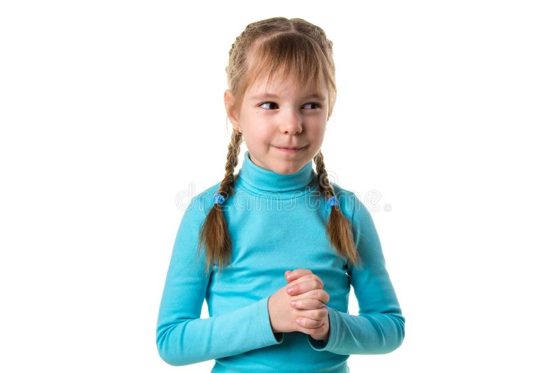 Retrato del primer del trazado disimulado, astuto, proyector de la muchacha algo aislado en el fondo blanco Emociones humanas neg foto de archivo