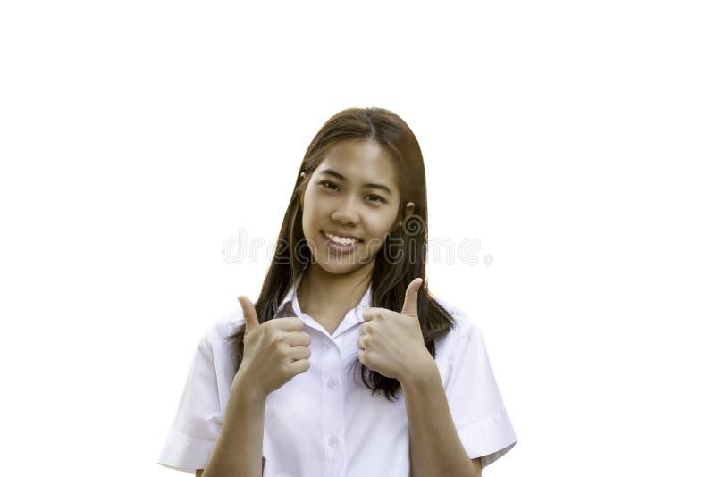 Retrato del uniforme sonriente de la universidad del estudiante con el pulgar para arriba en trayectoria de recortes fotos de archivo libres de regalías