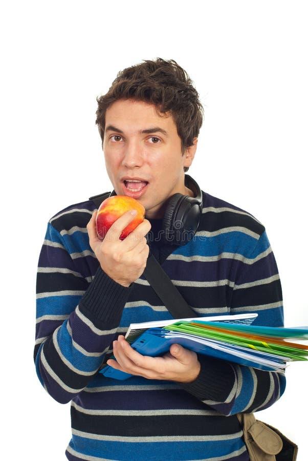 Retrato del varón del estudiante con la manzana imagen de archivo libre de regalías
