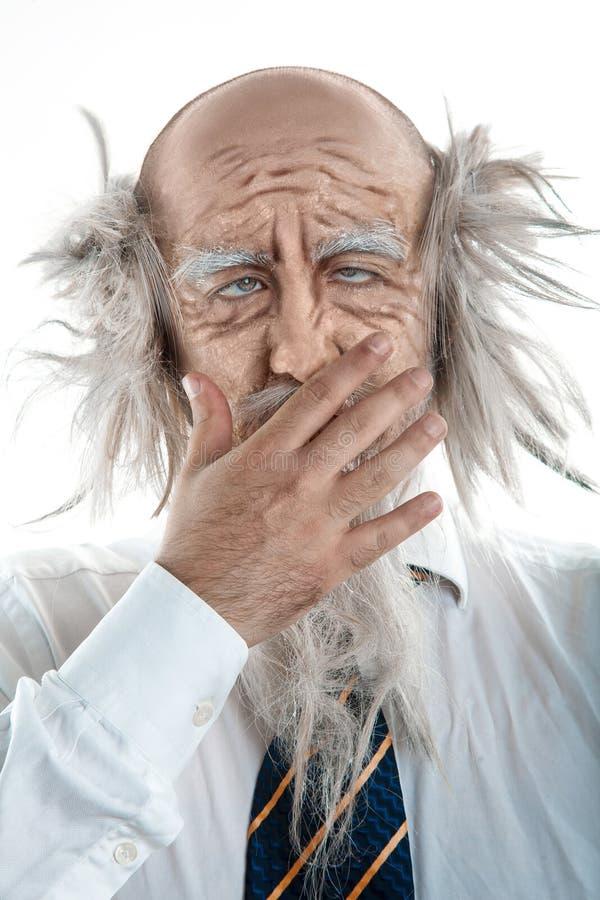 Retrato do ancião que boceja imagem de stock