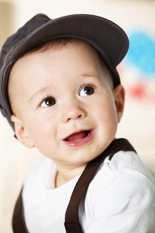 Retrato do bebé com tampão. fotografia de stock royalty free