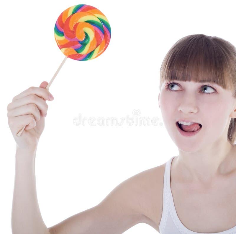 Retrato do blonde feliz com lollipop da cor fotografia de stock