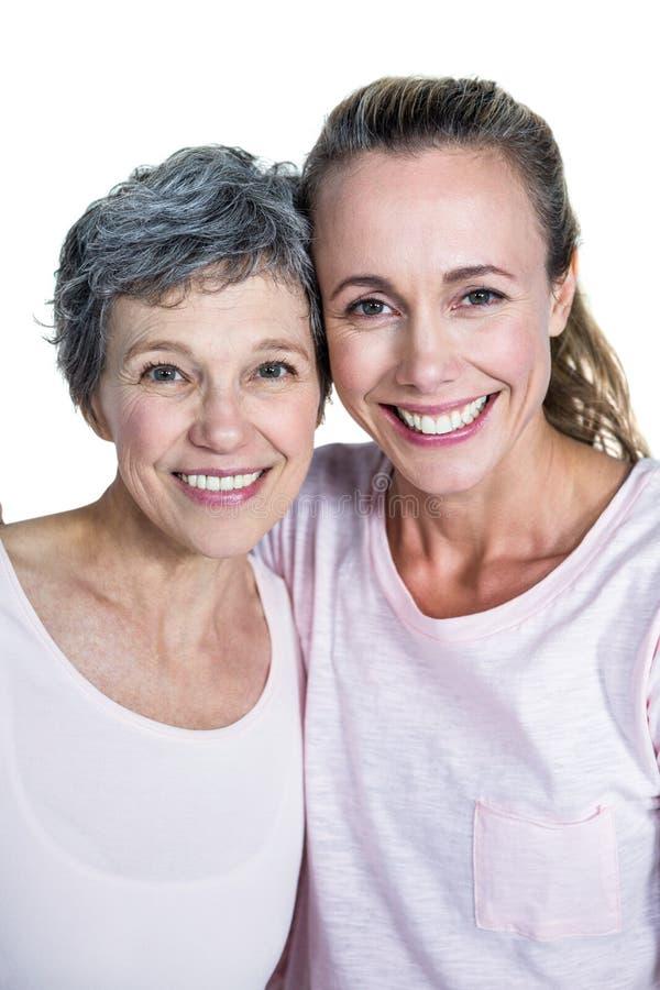 Retrato do close-up da mãe e da filha alegres fotografia de stock royalty free