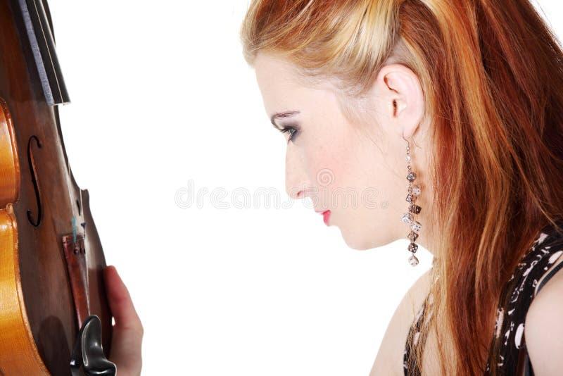 Retrato do Close-up da menina que olha o fiddle. fotografia de stock royalty free