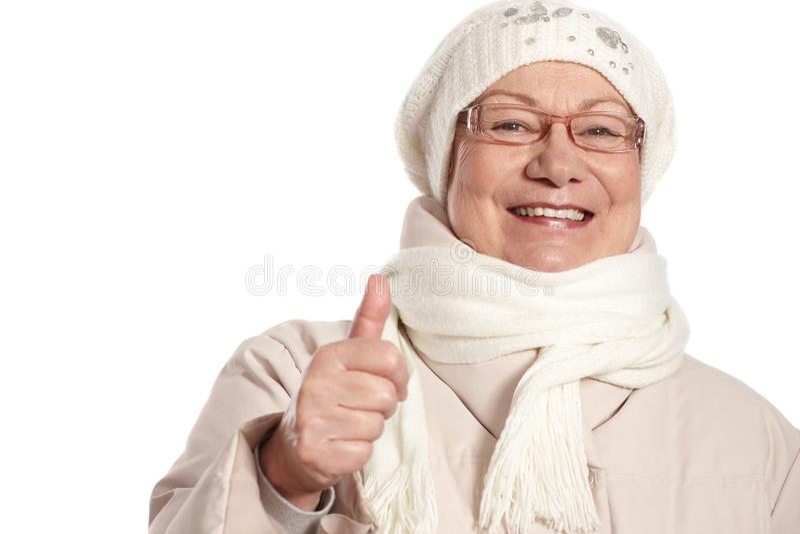 Retrato do close up da mulher idosa com polegar acima foto de stock royalty free