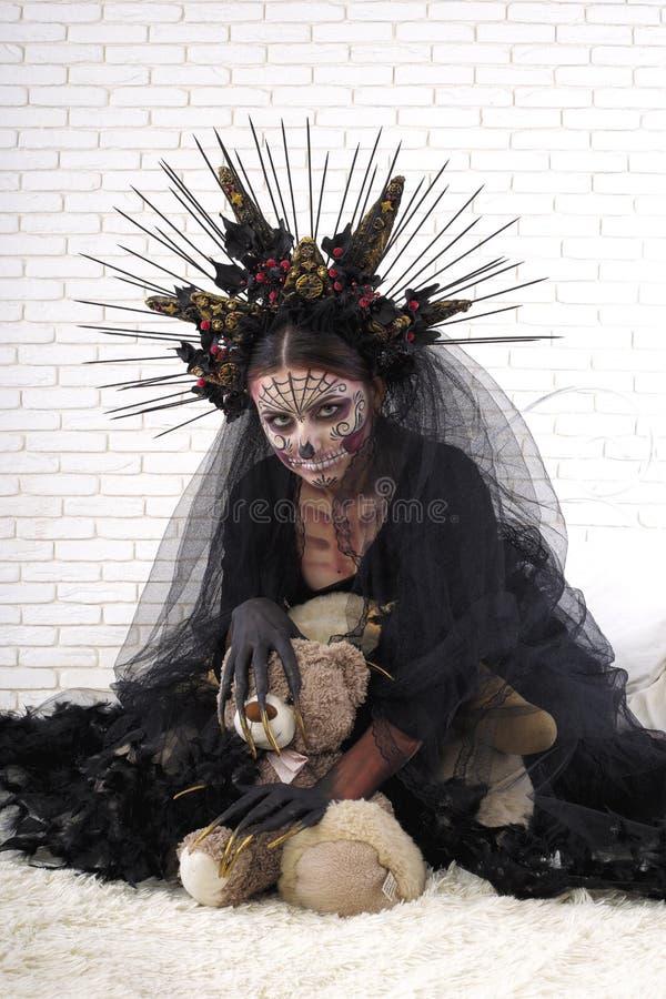 Retrato do close up de Calavera Catrina Jovem mulher com sku do açúcar imagens de stock