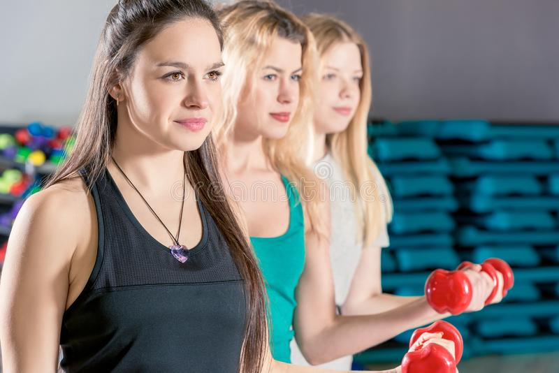 Retrato do close-up de três meninas no treinamento imagens de stock royalty free