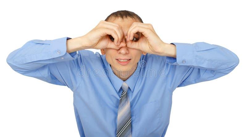 Retrato do close up do homem de negócios que olha à câmera com binocular imagens de stock