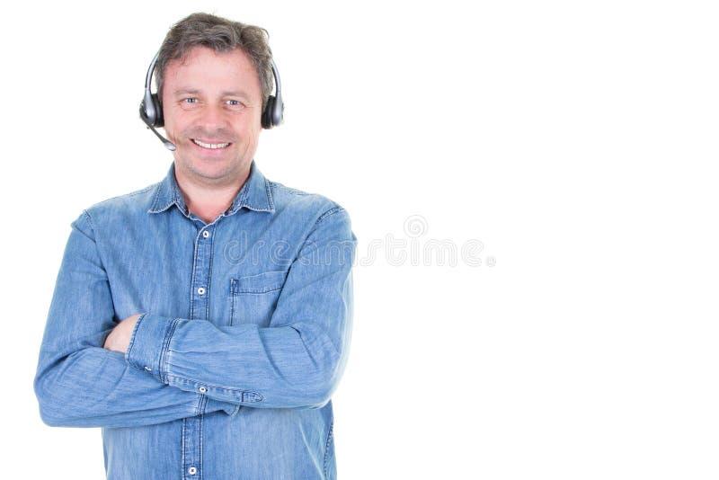 Retrato do consultante no telefone com os auriculares com copyspace lateral no callcenter fotografia de stock