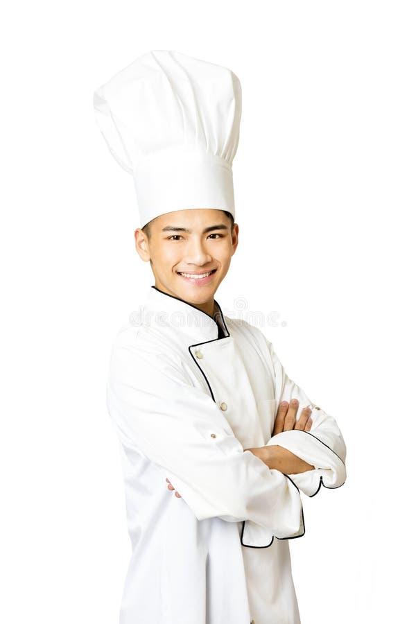 Retrato do cozinheiro chefe masculino novo isolado no branco foto de stock