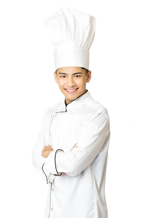 Retrato do cozinheiro chefe masculino novo no branco foto de stock