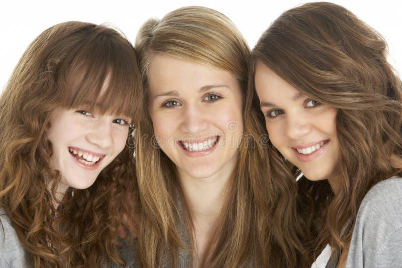Retrato do estúdio de três irmãs foto de stock