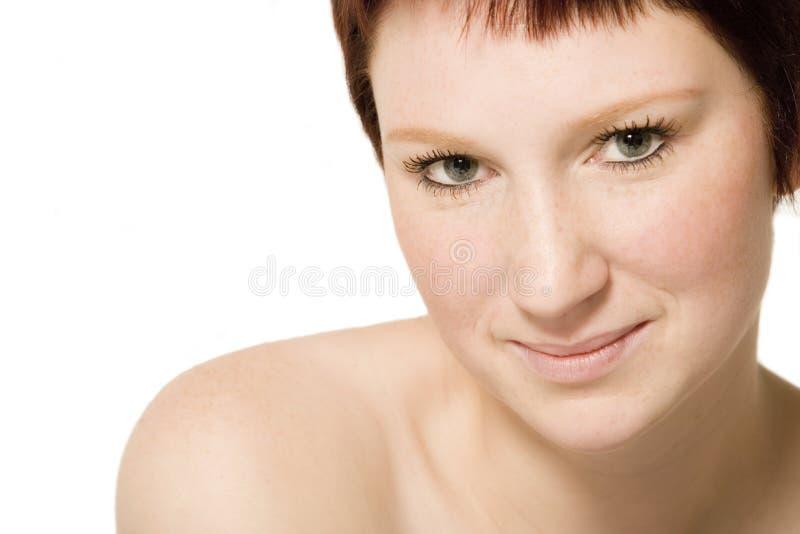 Retrato do estúdio de uma mulher nova flertando foto de stock