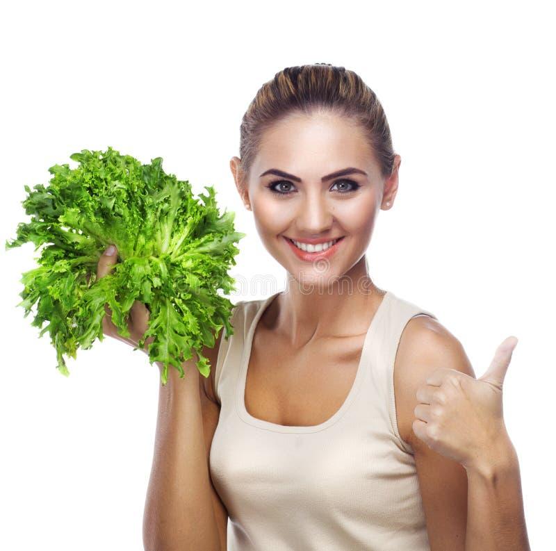 Retrato do Fim-acima da jovem mulher feliz com ervas do pacote (salat fotografia de stock