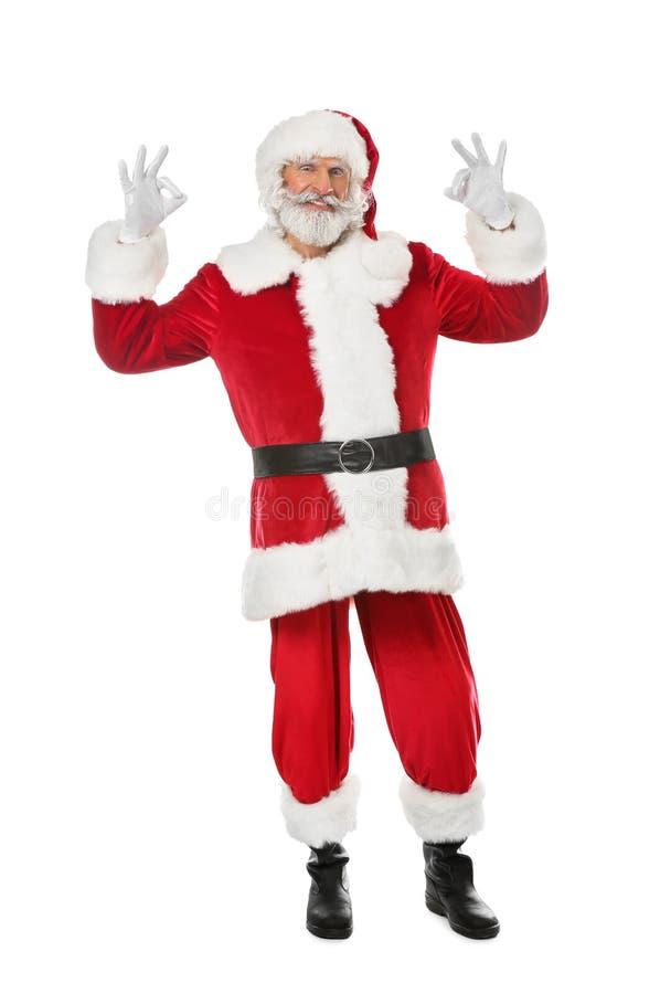 Retrato do gesto APROVADO da exibição de Santa Claus no fundo branco foto de stock