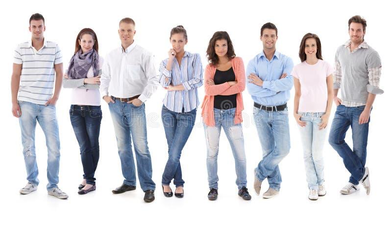 Retrato do grupo de povos ocasionais novos felizes imagens de stock