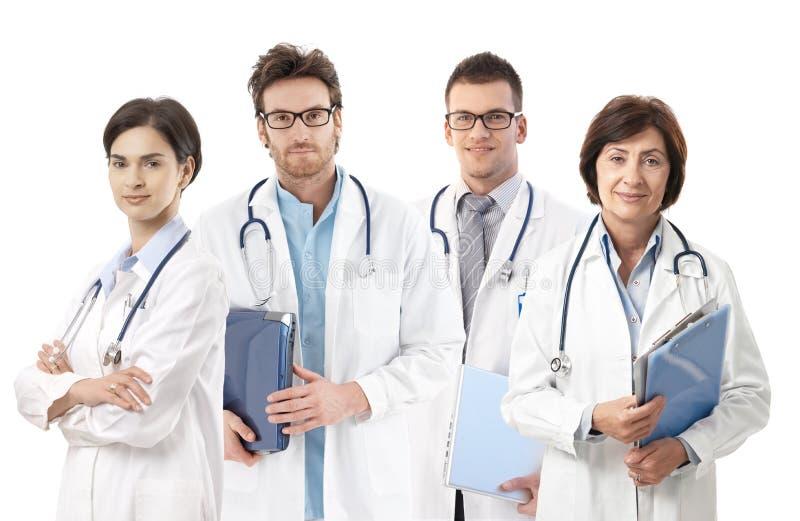 Retrato do grupo dos doutores no fundo branco imagens de stock royalty free