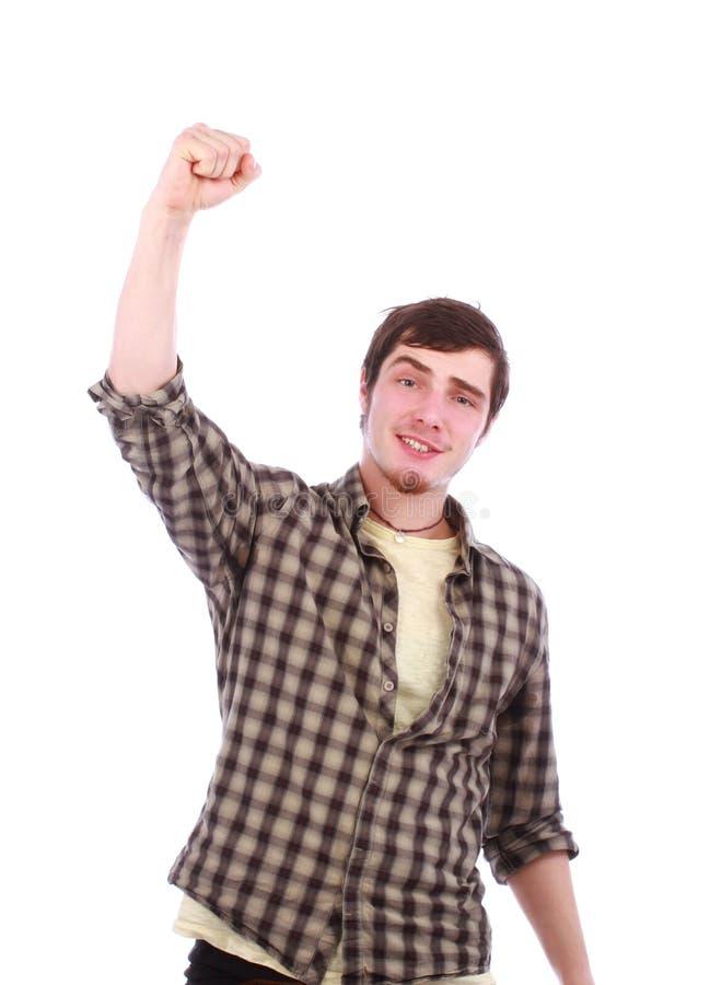 Retrato do homem bem sucedido novo que cheering e que aumenta o mão acima fotos de stock royalty free