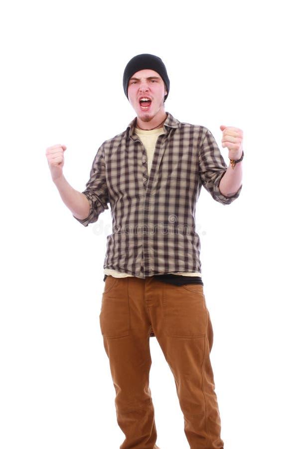 Retrato do homem bem sucedido novo que cheering e que aumenta o mão acima foto de stock