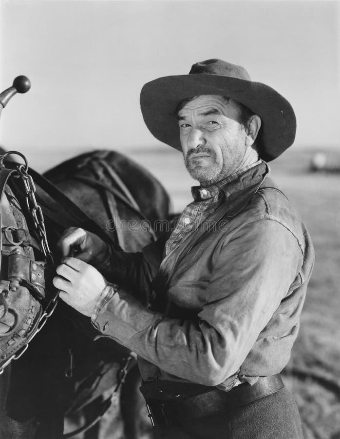 Retrato do homem com cavalo imagem de stock