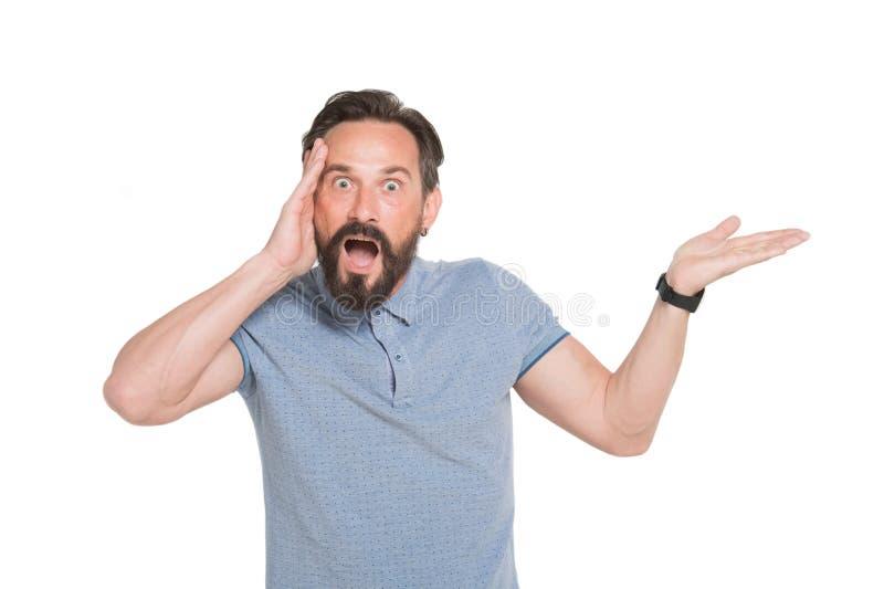 Retrato do homem confundido que toca em sua cabeça e que mantém sua boca aberta imagem de stock royalty free