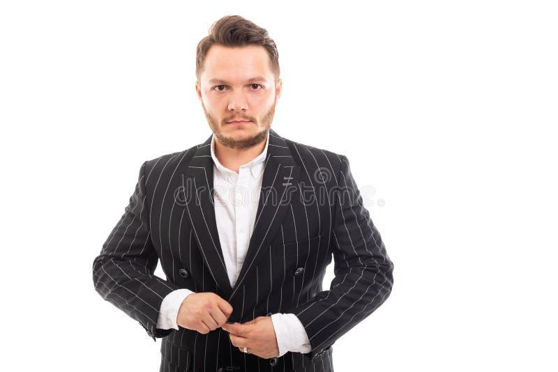 Retrato do homem de negócio novo que abotoa-se acima do revestimento fotos de stock