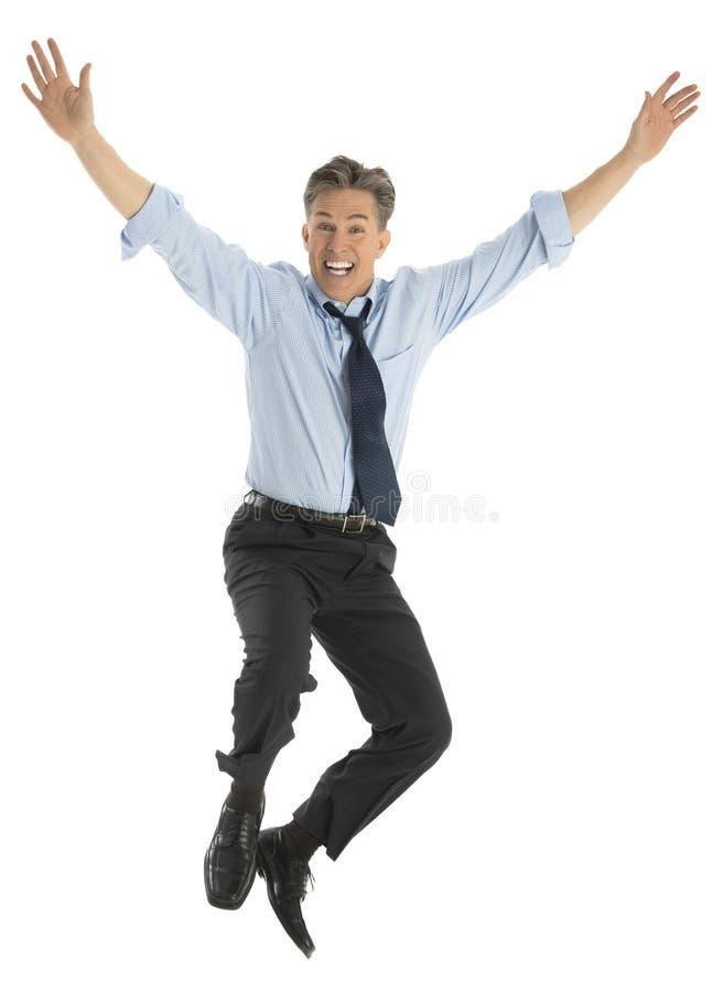 Retrato do homem de negócios bem sucedido Jumping In Joy fotografia de stock royalty free