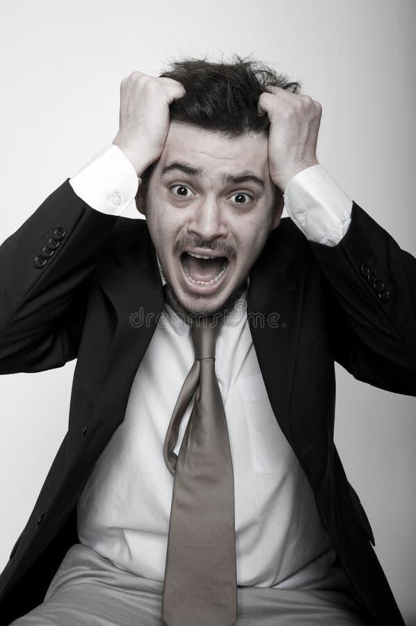 Retrato do homem de negócios forçado irritado imagem de stock royalty free