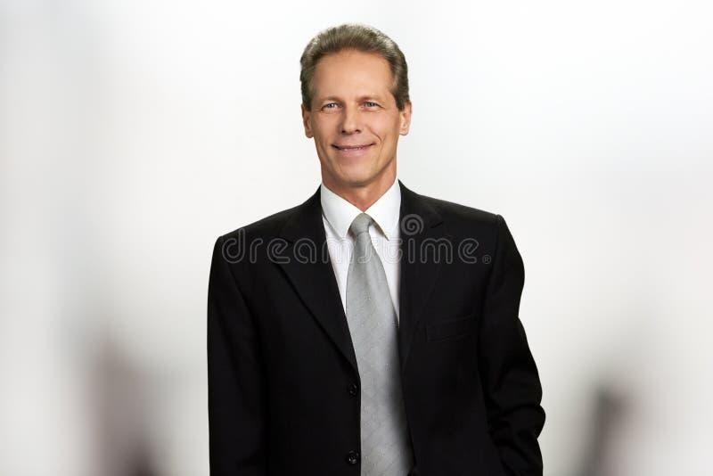 Retrato do homem de negócios maduro alegre fotografia de stock royalty free