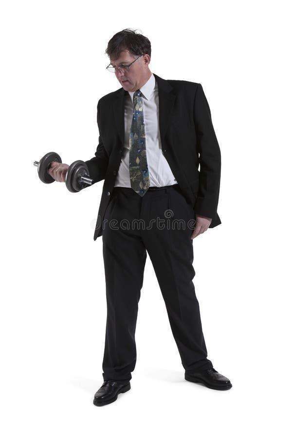 Retrato do homem de negócios maduro Lifting Dumbbell imagens de stock royalty free