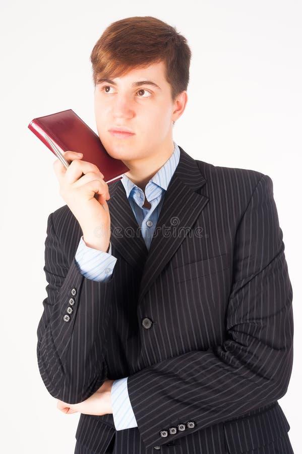 Homem de negócios que guardara o registro do diário imagens de stock