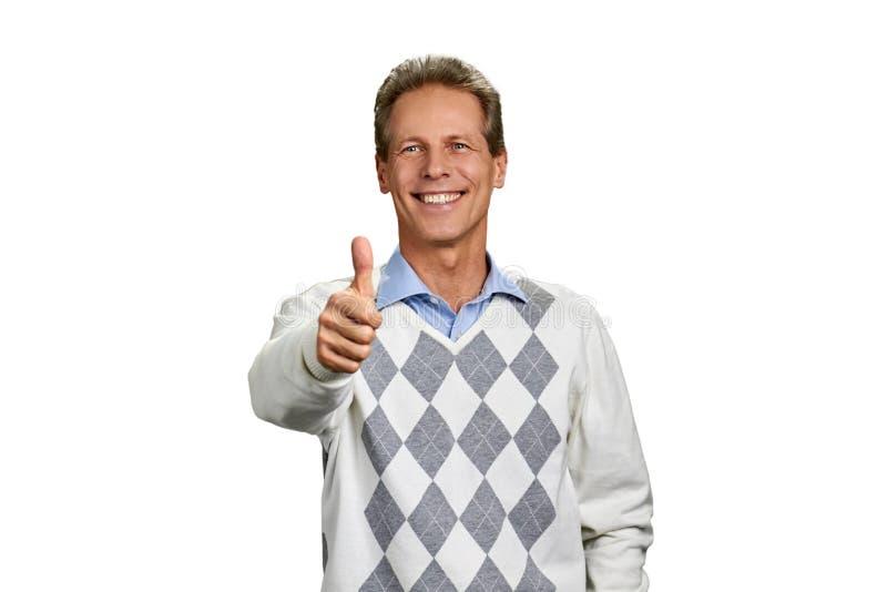 Retrato do homem feliz com o polegar acima do sinal fotografia de stock