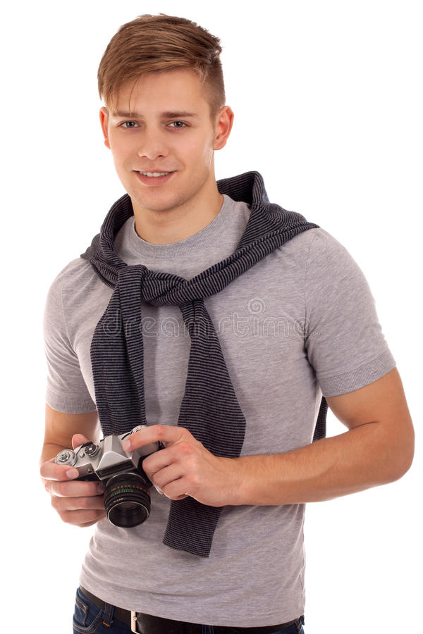 Retrato do homem novo com câmera do vintage imagem de stock
