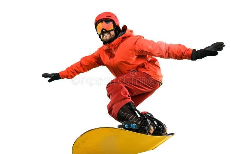 Retrato do homem novo no sportswear com o snowboard isolado em um fundo branco fotos de stock