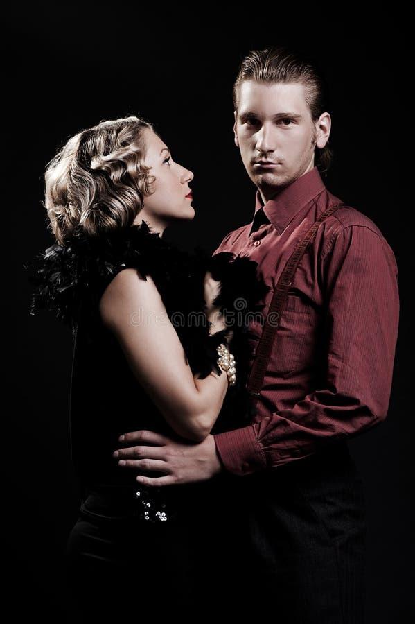 Retrato do homem sério e da mulher bonita foto de stock