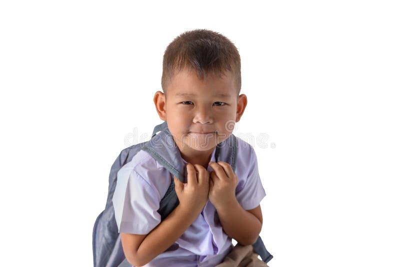 Retrato do menino de pa?s asi?tico na farda da escola isolada no fundo branco fotos de stock royalty free