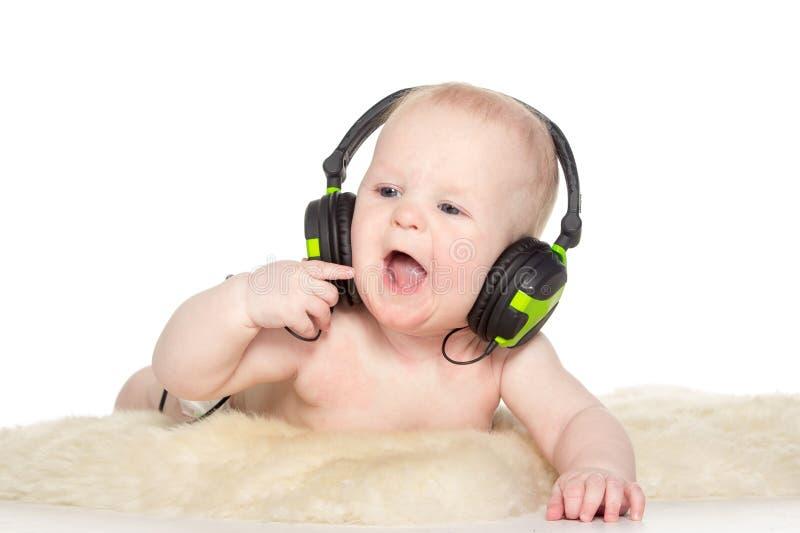 Download Retrato Do Menino Do Bebê De Seis Meses Com Auscultadores Foto de Stock - Imagem de clipping, cute: 29837766