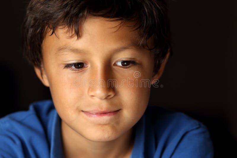 Retrato do menino novo - série do claro-escuro imagem de stock royalty free