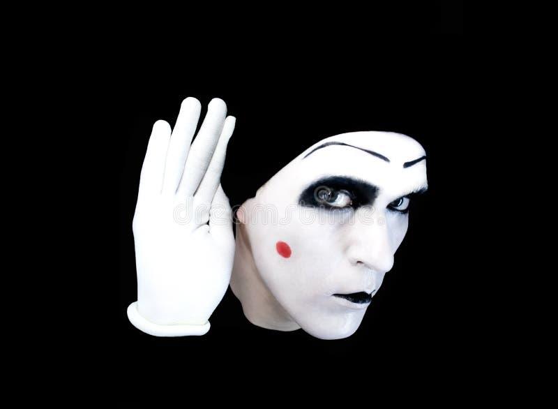 Retrato do mime overhearing nas luvas brancas fotografia de stock