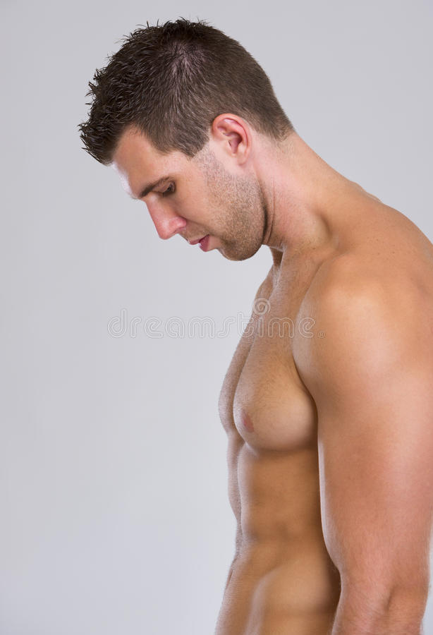 Retrato do perfil do homem muscular forte fotos de stock